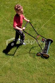 boy pushing rotary mower